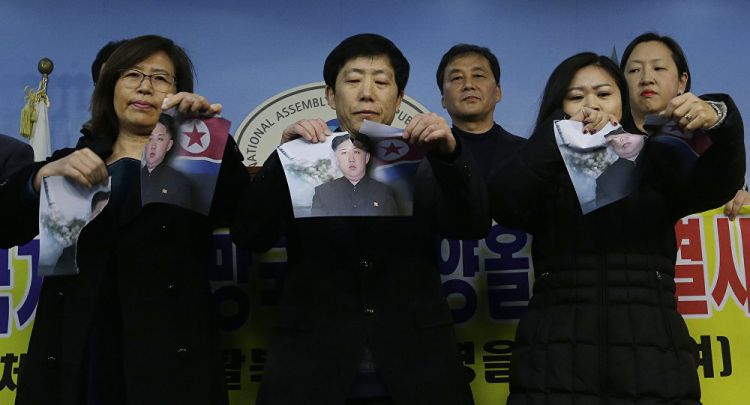 Protests Over 'Hijacked' Olympics: S Korean Activists Rip Kim Jong-un's Portrait